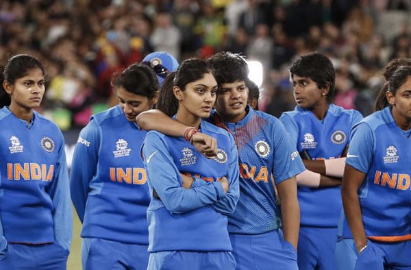 India look dejected after the ICC Women's T20 Cricket World Cup Final match between India and Australia at the Melbourne Cricket Ground on March 08, 2020 in Melbourne, Australia.
