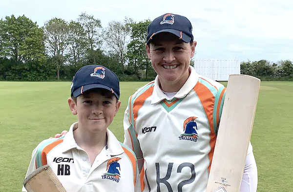 Harry Brindle (left) and his mother Arran Brindle scored 143 runs for the 1st wicket in just 32.3 overs (@FirstTrojans Twitter Photo)